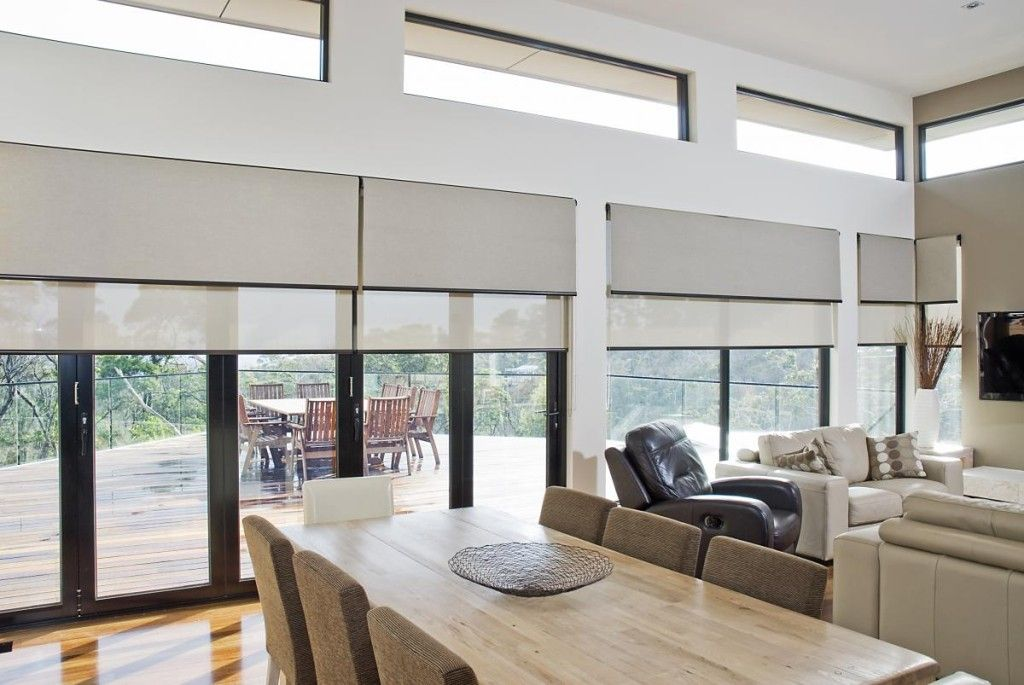 double roller blinds over large space livingroom