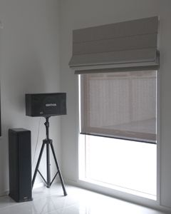 brown roman blinds half opened